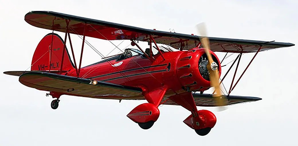 What a cool red vintage 1930s biplane.. Rides available at Ozwest in Perth.