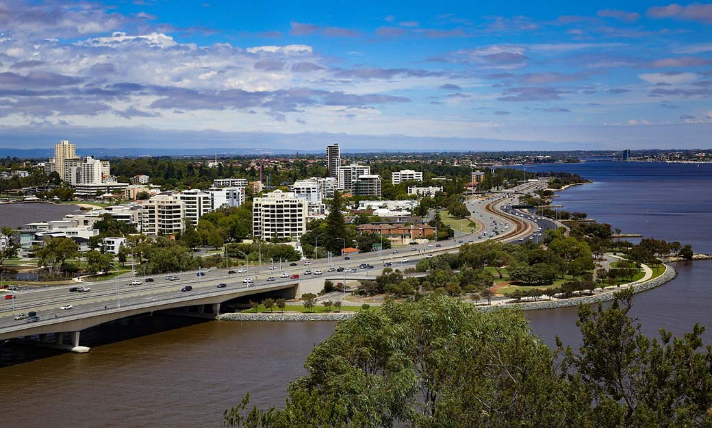 A view of Perth showing downtown, the Swan  river and the Narrows bridge.