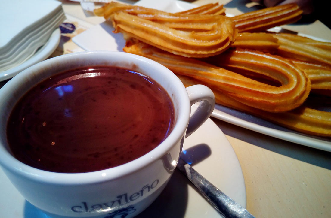 A plate of churros and a cup of thick, dark hot chocolate makes a perfect Spanish breakfast.