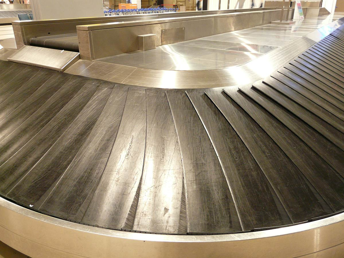 An empty airport baggage carousel can signal the worst--you're a victim on the lost luggage gremlins.
