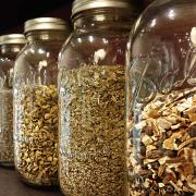 Ball jars full of teas and spices wait for the experts at David Rio Chai Tea to blend them into new concoctions.