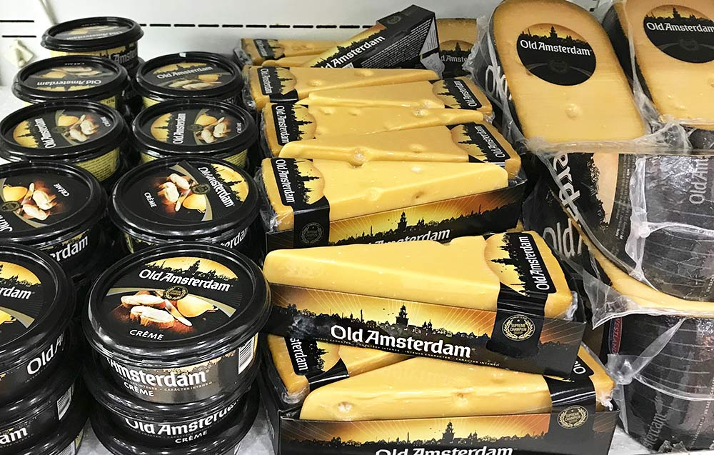 "An assortment of ""Old Amsterdam Aged Gouda Cheese"" in a supermarket in Aruba."
