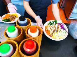 Adding Sauce to the Rice Bowl
