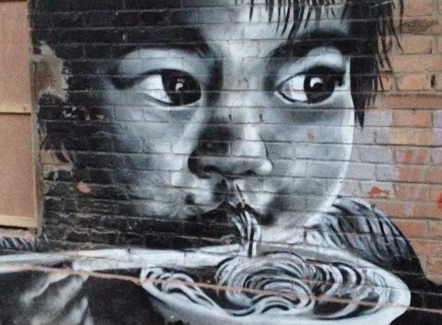 Mural of Asian child slurp a bowl of noodles