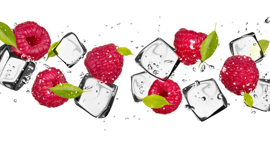 clear ice makes cool drinks - Raspberries with ice cubes, isolated on white background