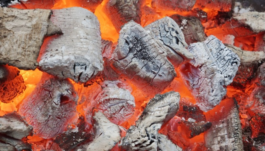 Glowing Coals in BBQ Pit. Background or Texture for text or image