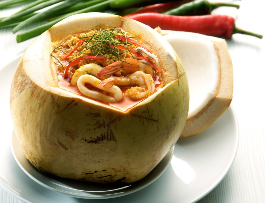 coconut as outer vessel - Thai Food Tom Yum seafood