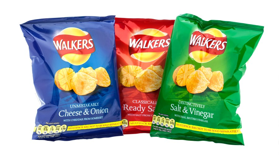 Opaque bags cuts down UV that can induce the free radical reactions that lead to oxidation and rancidity - SWINDON, UK - APRIL 13, 2014: Three packets of Walkers crisps isolated on a white background. Walkers is a British snack food manufacturer
