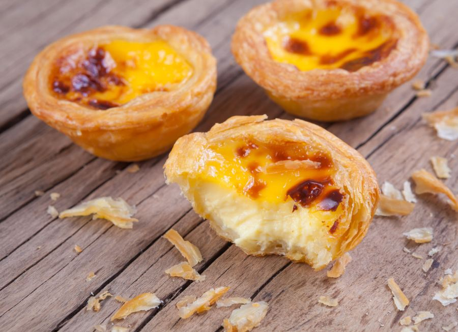 delicious portuguese egg tart on wood background