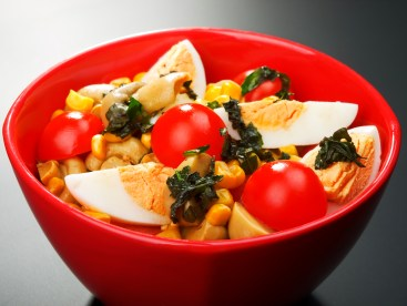 Salad with cherry tomato, eggs and corn