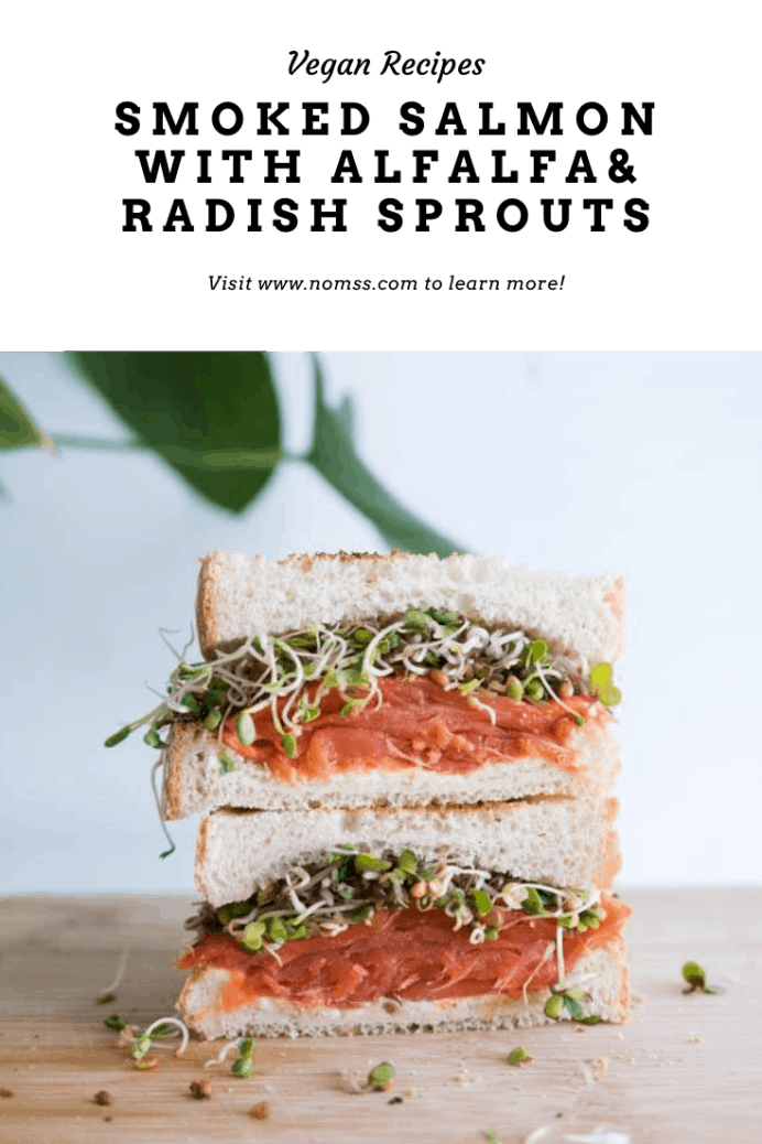 This supersized smoked salmon sandwich with sprouts, and creamy dill cream cheese is perfect for brunch or afternoon tea. Most grocery stores sell pre-sliced smoked salmon and cream cheese, which makes this recipe super easy! Top it with some homegrown alfalfa sprouts, capers and thinly sliced red onions for an extra layer of delicious crunch!  #sandwich #smokedsalmonsandwich #afternoonteasandwich #teasandwich #lox #bagelparty #brunchrecipes #easysandwiches #instanomss