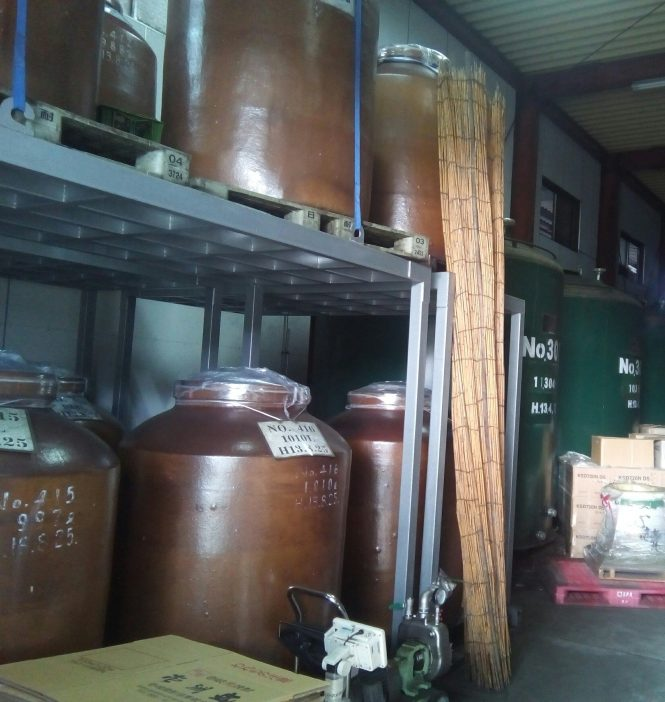 Shochu aging in ceramic urns and steel tanks