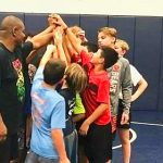 Lake Nona Junior Lions Coach Shares Wrestling Passion With Young Athletes