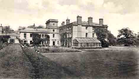 The house and terrace viewed from the south. The walled garden is to the left, the Majesty Oak to the right, both out of view