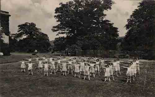 Pupils exercising on the lawn