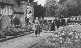 The Duke of Kent and Miss Wright entering the old house gardens, during his visit to Nonington College in June, 1939