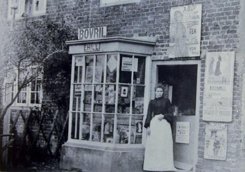 Easole-Mrs Hill in shop door-way