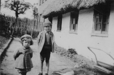 A closer view of the rear of the cottages. Church Street is up the bank to the left. The names of the children are unknown.