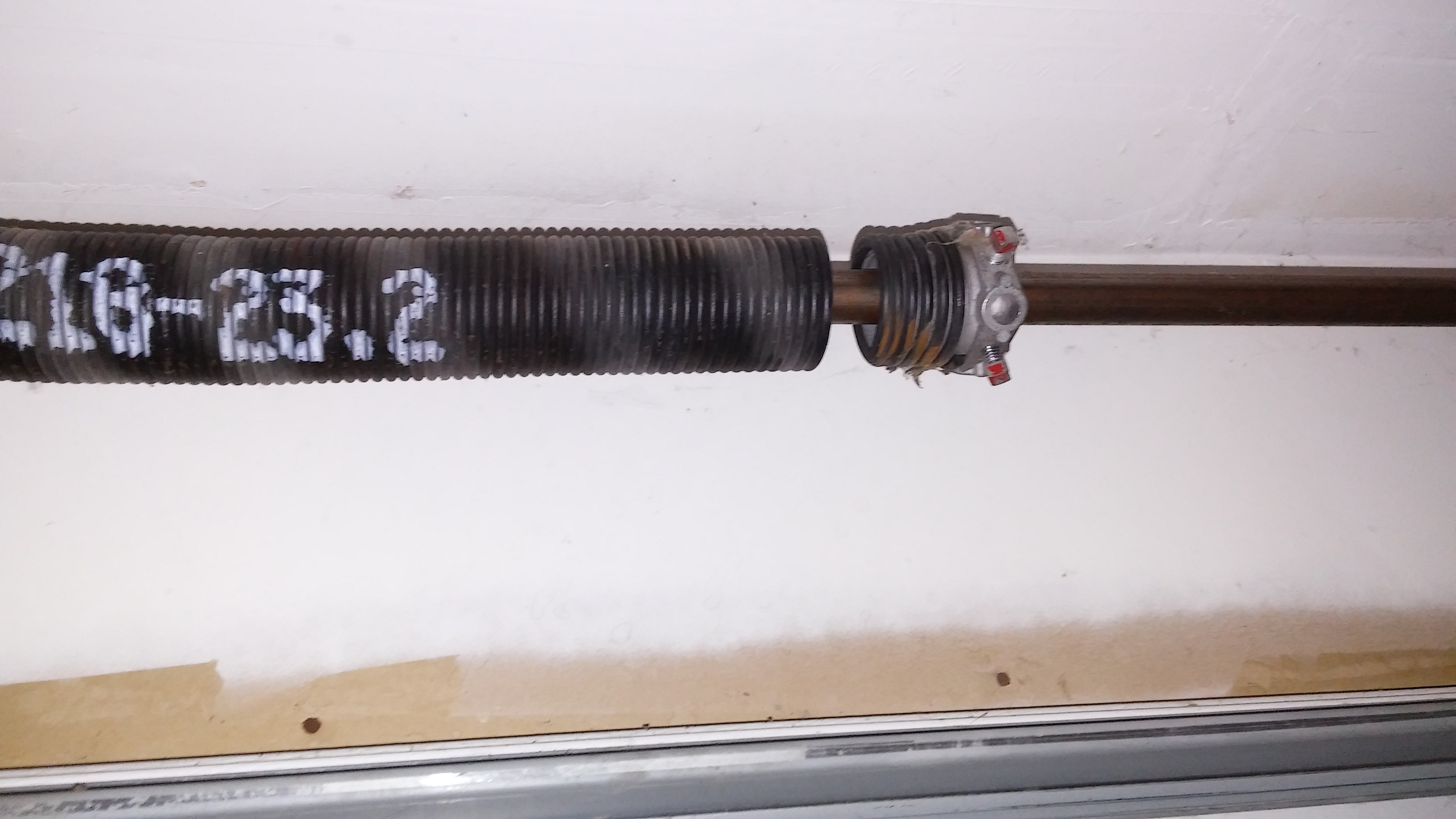 How to replace a garage door spring no nonsense landlord for Replace garage torsion spring