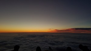 catching the sunset from the top of Mount Fuji