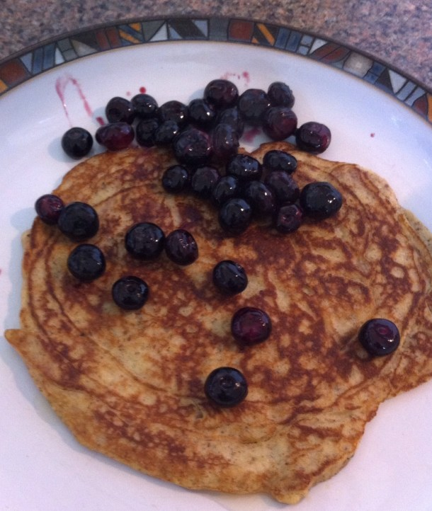 Pancakes, Paleo style, with cooked blueberries and a dash of agave nectar