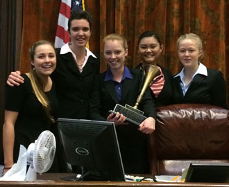 Dos Pueblos High School captains Bela Lafferty, Delia Bullock, Madeline Matthys, Sophia Zheng and Camille Wyss show off their first-place trophy. (Uptal Thakrar photo)
