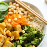 peanut tofu buddha bowl with chopsticks