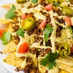 """Ultimate Fully Loaded Vegan Nachos: with vegan nacho cheese sauce and vegan taco """"meat""""!"""