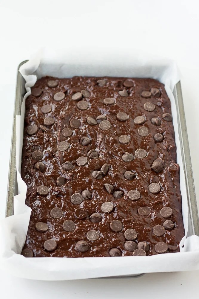 vegan brownies batter in pan with parchment paper