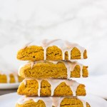 stack of vegan pumpkin scones with white background