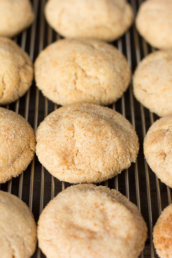 many vegan snickerdoodles on cooling rack
