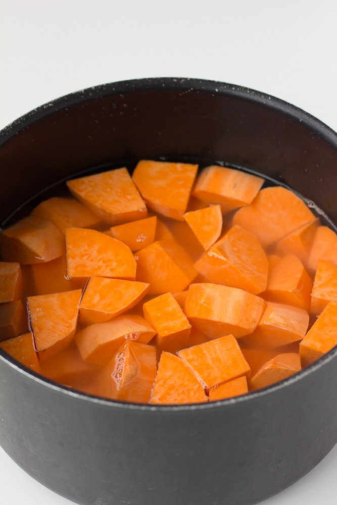 sweet potatoes uncooked in water for vegan sweet potato casserole