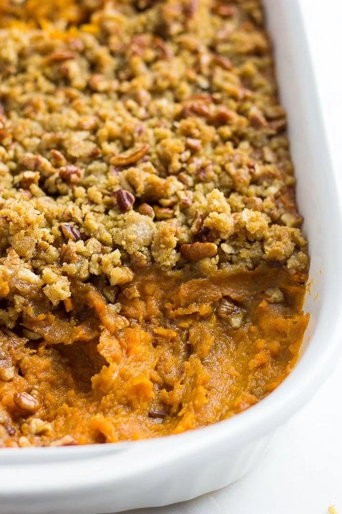 vegan sweet potato casserole with some taken out of the dish