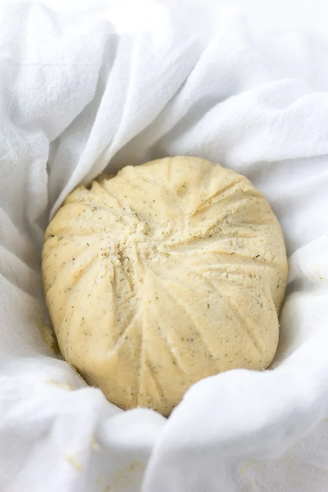 vegan cheese ball after being wrapped and chilled