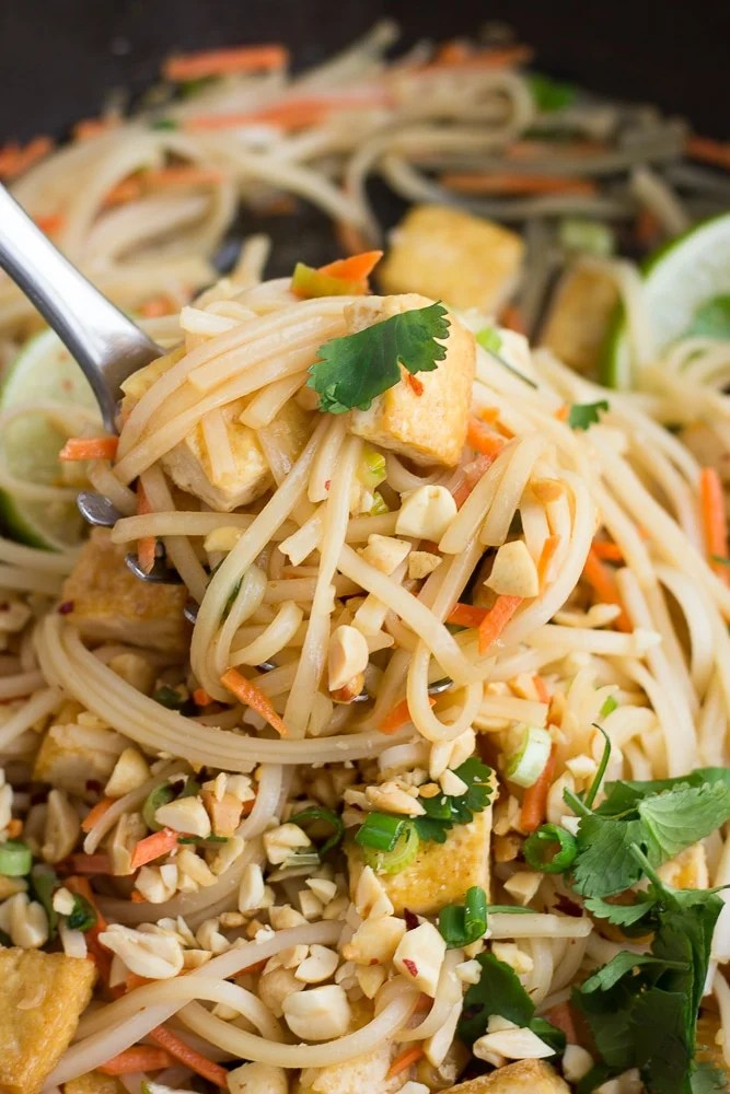large spoon with lots of vegan pad thai on it