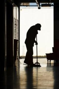 Man mopping factory floor
