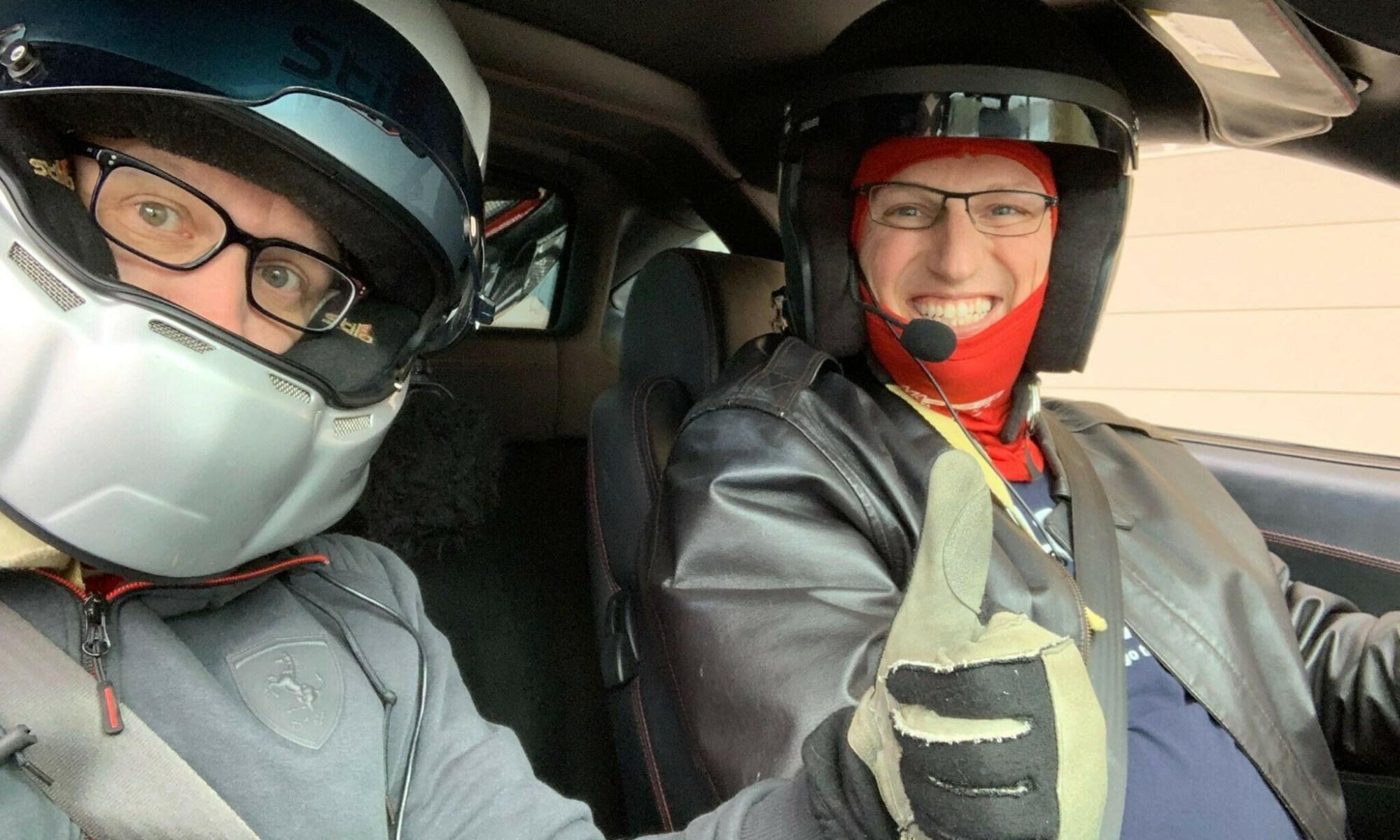 Dan wearing a helmet in his Ferrari F430 at COTA