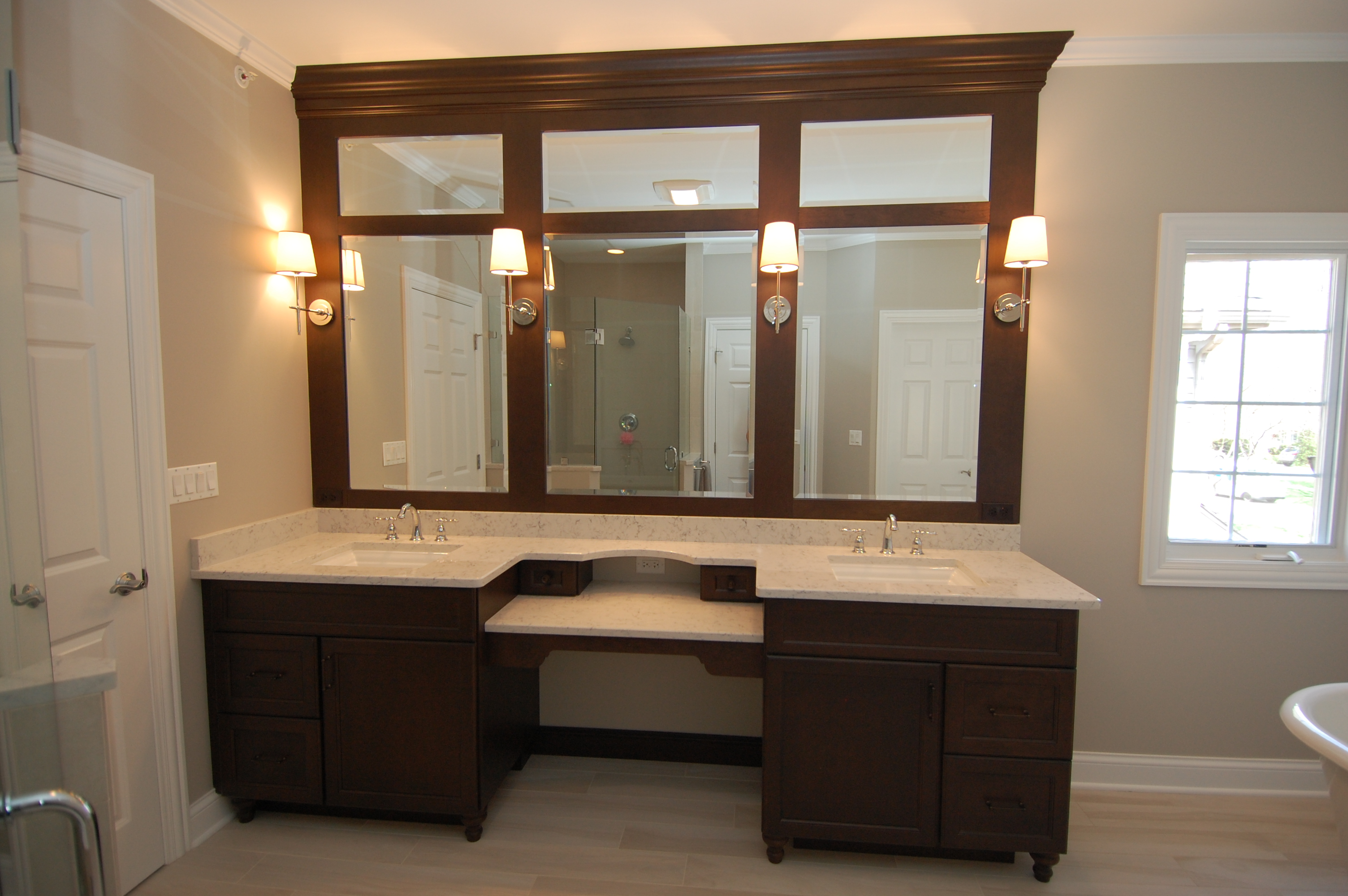 double vanity with lower makeup table