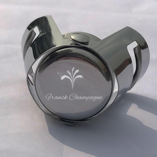 Lukkemekanisme til champagne