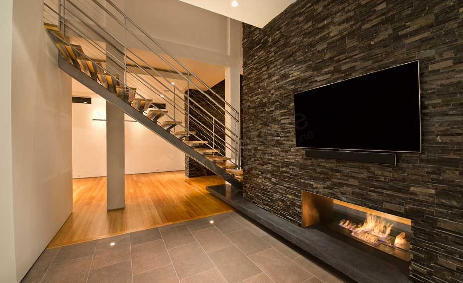 Interior Stacked Stone Veneer Wall Panels   Interior Stone Cladding Natural Stacked Stone Veneer Wall Cladding on Interior Wall with TV and a  fireplace