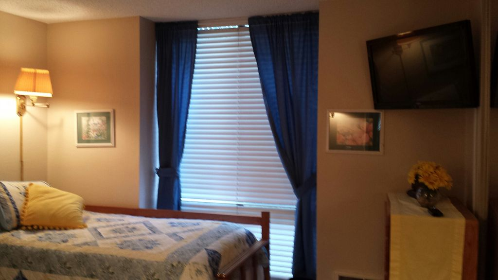 A-17 bedroom with hanging flat screen tv