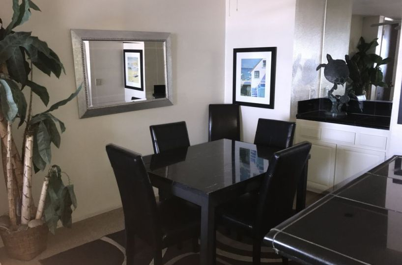 a201 dining table seats 5 with mirror on the wall