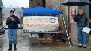 Northampton High-speed Community Network Coalition gathering signatures at Hot Chocolate Run, Northampton MA on December 2, 2018