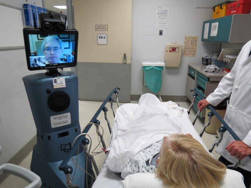 Dr. Tegeler shows how he would examine a patient via the robotic telestroke program.