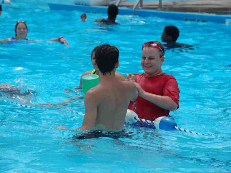 KIds play in the pool at Camp Royall, a camp for people with autism of all ages run by the Autism Society of North Carolina. Photo: Kelsey Tsipis