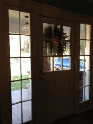 The window by the front door where Stephanie Jones' son was chewing the white panes between the glass panels.