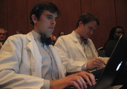 Medical students William McLean (l) and Eli Tiller (r) put the finishing touches on their presentation for the Medicaid Reform Advisory Group Wednesday.