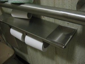 photo of ashtray that's part of toilet paper dispenser