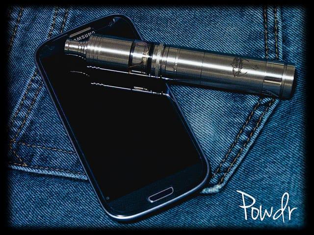 e-cigarette next to a mobile phone