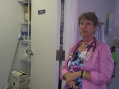 Leslie Sharpe, stands in the laboratory space of the Sylvan Health Center where blood samples and the like are stored.